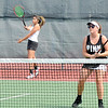 John P. Cleary | The Herald Bulletin <br /> Abby Williams returns a shot as doubles partner Alexys Rastetter plays the net in their Woman's A doubles match against Maddie Shannon and Billie Davis  in Community Hospital Anderson Tennis Classic action Saturday. Williams and Rastetter won the match 6-2, 2-6, 6-2.