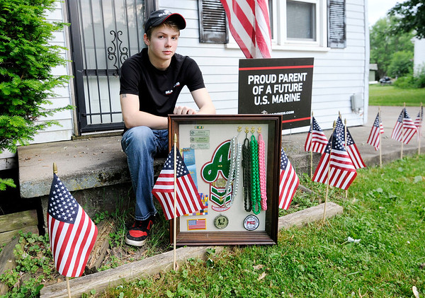 Don Knight | The Herald Bulletin<br /> Anderson High School junior and NJROTC member Ethan Brady has worked to graduate a year early and will be shipping out for Marine Corp training later this month. But he will not be allowed to walk at graduation on Tuesday because the school will not receive his test scores from the state in time.