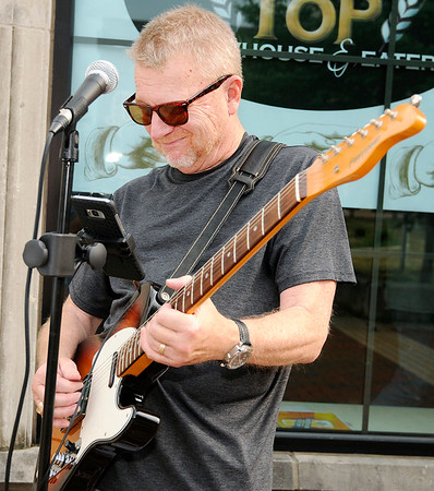 Don Knight | The Herald Bulletin<br /> Local musician Mike Fox performs outside A Town Center during Anderson's Inaugural First Friday Art Walk.