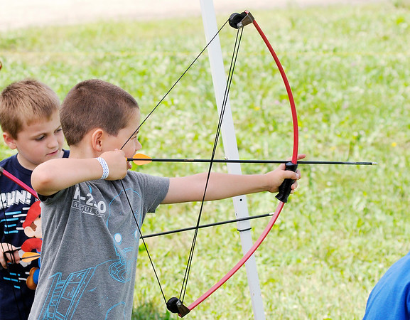 Don Knight   The Herald Bulletin<br /> Frank Daugherty, 6, takes aim on the archery range during a Sakima District  day camp for Cub Scouts at Athletic Park on Friday.