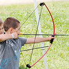 Don Knight | The Herald Bulletin<br /> Frank Daugherty, 6, takes aim on the archery range during a Sakima District  day camp for Cub Scouts at Athletic Park on Friday.