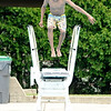 Don Knight | The Herald Bulletin<br /> Jermaine Hopkins, 14, jumps into the Southside Pool in Anderson on Wednesday. The pool is open Tuesday, Wednesday, Thursday and Sunday from Noon to 7 p.m., on Friday and Saturday from Noon to 8 p.m. and closed on Monday. The cost is $2 per person cash only and children under 3 get in free.