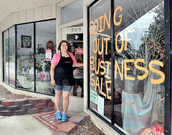 John P. Cleary   The Herald Bulletin <br /> Shari Collins, manager of the Posy Shop, out front of the shop where they are closing after 70 years in business.