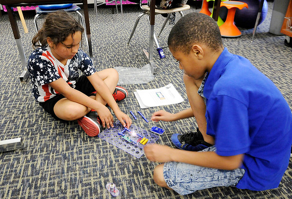 Don Knight   The Herald Bulletin<br /> From left, Jadelynn Smith and Armani Bonner use a kit from Snap Circuits to create a circuit with a switch and a light bulb during the Electricity in a Snap science program at Valley Grove Elementary on Wednesday.