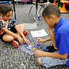 Don Knight | The Herald Bulletin<br /> From left, Jadelynn Smith and Armani Bonner use a kit from Snap Circuits to create a circuit with a switch and a light bulb during the Electricity in a Snap science program at Valley Grove Elementary on Wednesday.