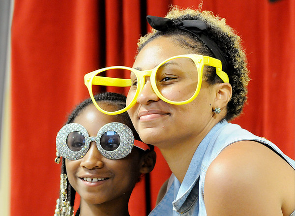 Don Knight | The Herald Bulletin<br /> Jessica Hughes and her daughter Daijah, 9, pose for a photo as Anderson Public Library kicked off their Summer Reading Program with a carnival on Thursday. The program's goal for the summer is 1,000,000 minutes.