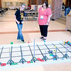 Don Knight | The Herald Bulletin<br /> From left, Kenden Miller talks to Kim Anderson about VEX Robotics during the eLead regional technology conference at Anderson High School on Tuesday. Miller is a fifth grader and member of Alexandria's robotics team.