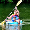 John P. Cleary | The Herald Bulletin <br /> Robin Ranaphyali, and her four year-old son Roman, enjoy a little kayaking on the waters of Shadyside Lake Monday afternoon after Robin got off work.