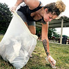 John P. Cleary | The Herald Bulletin<br /> Volunteers for Walk For Hope, like Jordin Griggs, helped cleanup Walnut Street Park Thursday evening in advance of their event & walk this Saturday at the park to raise awareness for addiction.