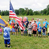 Don Knight | The Herald Bulletin<br /> Cub Scouts start their day with the Pledge of Allegiance during a Sakima District day camp at Athletic Park on Friday.