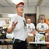 John P. Cleary | The Herald Bulletin<br /> Phil Sveum, Helping Hands Food Pantry manager, gives a final word to volunteers before they start distributing food Monday evening.