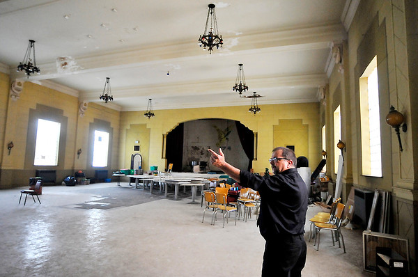 John P. Cleary | The Herald Bulletin <br /> FOE president Brent Woolard points out areas that need repair from water damage in the ball room of the lodge building. The roof as been repaired but funds are tight to start refurbishing the large room.