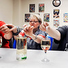 John P. Cleary | The Herald Bulletin <br /> Judy Fowler, Darlene Renner, and Iris Jensen prepare to drop their Alka  Seltzer tablets into their glasses to create 'Wine glass lave lamps' during the Alexandria Public Library's STEM night for adults this past week.