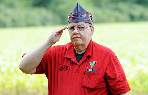 Don Knight | The Herald Bulletin<br /> Forty and Eight Correspondant Keith Hubbard salutes as the Daleville American Legion Post 446 Honor Guard fires three volleys and performs Taps during the flag retirement ceremony at Forty and Eight on Thursday. The ceremony is held annually on Flag Day.