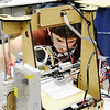 Don Knight | The Herald Bulletin<br /> Austin Fuller uses a piece of paper as a gauge as he adjusts the printer head during a 3D printing workshop at the Purdue Polytechnic Institute on Friday. As part of the workshop students assembled their own 3D printer.