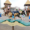 John P. Cleary | The Herald Bulletin <br /> Daleville Police officer Justin Melnick likes to take Dita, his K9 partner, to the Daleville Park where Dita loves to run and jump on the playground equipment, much to the delight of the kids that are there.