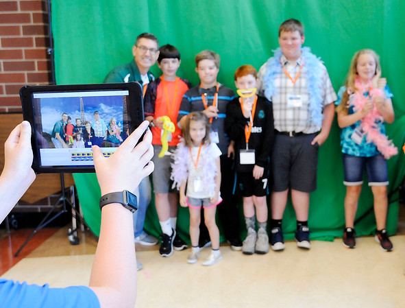 Don Knight | The Herald Bulletin<br /> Students demonstrate a green screen app during the eLead regional technology conference at Anderson High School on Tuesday.