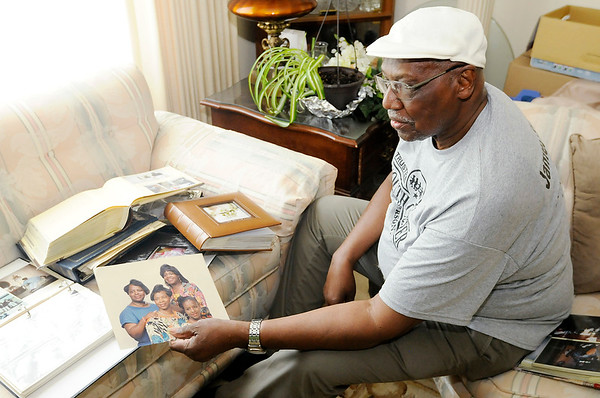 Don Knight   The Herald Bulletin<br /> James Warner holds a picture of four of his daughters at his Anderson home on Friday.Warner is organizing a Father's Day Walk that will be part of festivities marking the opening of the Anderson Township Trustee's new field house.