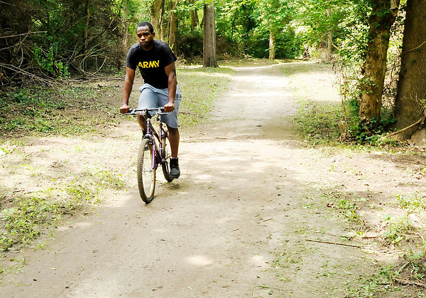 Don Knight | The Herald Bulletin<br /> A cyclist rides on the White River trail east of Edgewater Park on Wednesday. The city has been clearing brush from the river trail from Edgewater Park to the Scatterfield bridge.