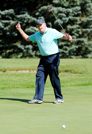 Don Knight   The Herald Bulletin<br /> PGA Tour Champion John Mahaffey reacts after just missing a long putt on the 18th green during the St. Vincent Classic for Kids at the Anderson Country Club on Friday. Mahaffey attempted one putt for each team competing.