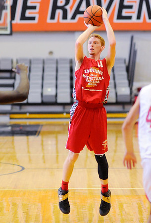 Don Knight   The Herald Bulletin<br /> Austin Lyons scores a three-point basket during the Indiana Class Basketball All-Star Classic at Anderson University on Friday.