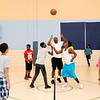 Don Knight | The Herald Bulletin<br /> Students play basketball at the UAW during Summer Camp at the Anderson Township Trustee Youth Center. The camp averages around 140 kids each day.