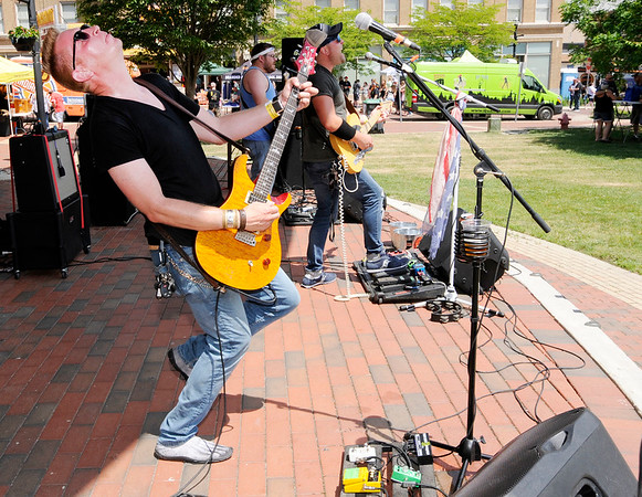 Don Knight | The Herald Bulletin<br /> Dave Anes on guitar with The Walker Band as the play on the Dickmann Town Center Stage during Anderson On Tap on Saturday. In the background from left are Clint and Jake Walker. Not pictured but on drums was Alan McCurdy.