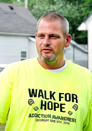John P. Cleary   The Herald Bulletin<br /> Volunteers for Walk For Hope gathered with Ryan Troub to cleanup Walnut Street Park Thursday evening in advance of their event & walk this Saturday at the park to raise awareness for addiction.
