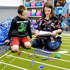 Don Knight | The Herald Bulletin<br /> From left, Deakin Crouse and Xander Layman look at their next project during the Electricity in a Snap science program at Valley Grove Elementary on Wednesday.