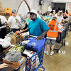 John P. Cleary | The Herald Bulletin<br /> The St. John's Lutheran Church Helping Hands Food Pantry distributed its 5 millionth pound of food Monday evening.