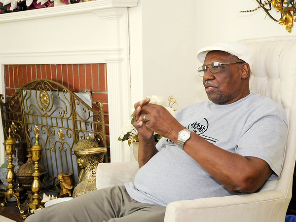 Don Knight | The Herald Bulletin James Warner talks about being a father during an interview at his Anderson home. Warner has been involved in the community including a radio show and an annual Thanksgiving meal.
