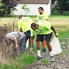 John P. Cleary | The Herald Bulletin<br /> Volunteers for Walk For Hope gather to cleanup Walnut Street Park Thursday evening in advance of their event & walk this Saturday at the park to raise awareness for addiction.
