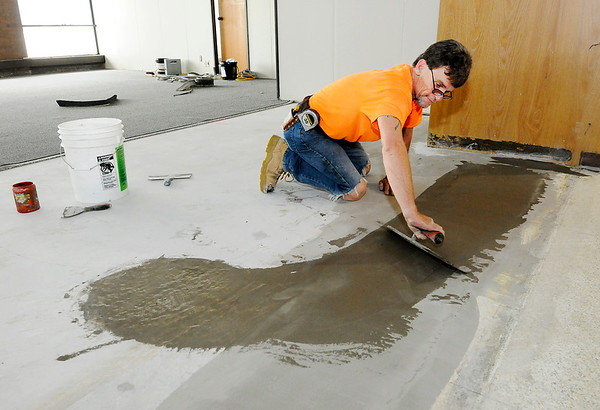 Don Knight | The Herald Bulletin<br /> Clark Patton with Indiana Flooring levels the subfloor so carpet can be installed on the second floor of the courthouse. The first and second floors are scheduled to be done by the end of July.
