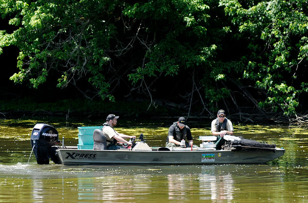 Don Knight   The Herald Bulletin<br /> DNR surveys the fish population at Shadyside Lake on Wednesday.
