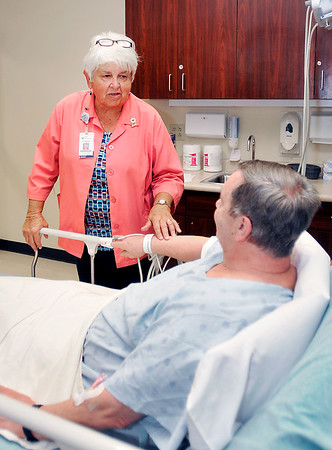 John P. Cleary | The Herald Bulletin<br /> St. Vincent Anderson emergency department volunteer Susan McDuffee talks with patient David Moore before he is released.