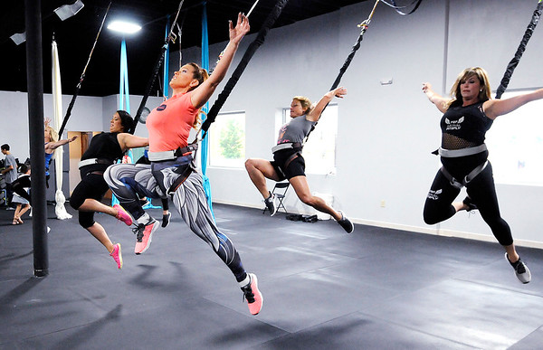 Don Knight   The Herald Bulletin<br /> Bungee instructor Charity Rees leads a demonstration during a grand opening for Aerial Fit2Fly at their 901 Meridian location in Anderson. Classes start on July 2nd.