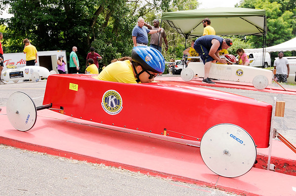 Don Knight | The Herald Bulletin<br /> Maryah Elliott, left, waits as her competitor Kaylee Wallace gets into position during the the Soapbox Derby on Saturday. The event returned after a four-year hiatus.