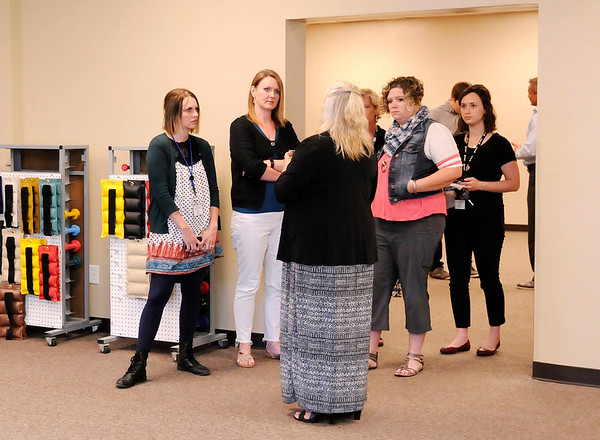 Don Knight | The Herald Bulletin<br /> Lissa Wright gives tours of Healing Hands new Anderson location during an open house on Wednesday.
