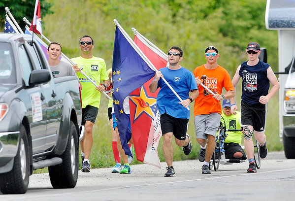 John P. Cleary | The Herald Bulletin <br /> Participants in the America's Run for the Fallen make their way west along Indiana 32 coming into Anderson Monday afternoon after taking a break in Chesterfield. They started in Portland at 7 a.m. and concluded the day at the Flagship Enterprise Center on their cross-country journey to honor fallen American service members.