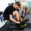 Don Knight | The Herald Bulletin<br /> Cadem Eicks tries on a pair of bounce shoes at Aerial Fit2Fly during their grand opening on Friday. Aerial Fit2Fly is offering six different exercise classes.