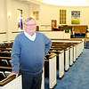 Don Knight | The Herald Bulletin<br /> Church of the Brethren Pastor Spencer Spaulding stands in the church's sanctuary.  The church was founded in 1893 and will be celebrating their 125th Anniversary this month.