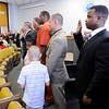 Don Knight | The Herald Bulletin<br /> Tyray Wilson, right, is one of nine new APD police officers sworn in during a ceremony on Tuesday at the City Building.