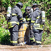 John P. Cleary | The Herald Bulletin<br /> Members of the Madison County HazMat team check out this abandoned barrel in the 2500 block of Monroe Street in Anderson Monday morning. This is the second incident of this natural in a week in the same area.