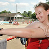 John P. Cleary | The Herald Bulletin<br /> Alexandria pool lifeguard Mackenzie Neeley applies a fresh coating of sunscreen to herself during her break before she goes back out poolside Thursday aftenoon.