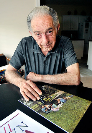 John P. Cleary | The Herald Bulletin <br /> John Grose points out his late wife as a child as her family was featured on the back cover of the  Small Town USA booklet on Alexandria from the 1940's.
