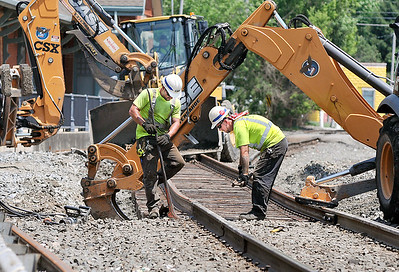 John P. Cleary | The Herald Bulletin  Crews from CSX Railroad started Monday tearing out and replacing the Meridian Street grade crossing just south of 14th Street. The street is scheduled to be closed through Friday.