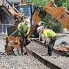 John P. Cleary | The Herald Bulletin <br /> Crews from CSX Railroad started Monday tearing out and replacing the Meridian Street grade crossing just south of 14th Street. The street is scheduled to be closed through Friday.