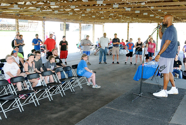 Don Knight | The Herald Bulletin<br /> Former globetrotter Derick Grant speaks about overcoming hardship during a cookout at Anderson Speedway for kids and adults affected by suicide on Saturday.