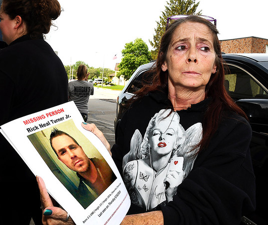 John P. Cleary | The Herald Bulletin <br /> Debbie Turner holds up flyers of her missing son, Rick Turner Jr., May 22, 2019.