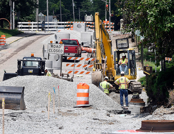 John P. Cleary | The Herald Bulletin Sewer work continues along College Dr. through Anderson University Tuesday                between East Fifth St. and University Blvd. When the project started just the northbound lanes were closed to traffic, now both lanes are shut down to traffic as work continues.